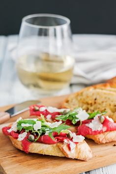 How to make beef carpaccio, on top of a toasted crostini, drizzled in a mustard horseradish sauce, and finished with zippy capers.
