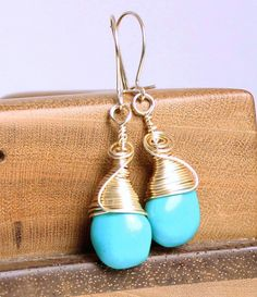 Timeless gold filled and blue turquoise drop earrings.    I used gold filled wire to wrap these turquoise stones into drops and swirls to hang delicately from gold filled ear wires. These blue minimalist earrings, evoking a Southwestern feel, are 1.5 inch long. A wonderful, understated piece of every day jewelry.      Handmade to order, earrings will ship out 1-3 business days from date of order and arrive ribbon wrapped in their own jewelry gift box.   | Shop this product here…