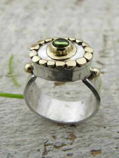 Ring | Osnat Omiya. Sterling silver, 14k gold and green Tourmaline