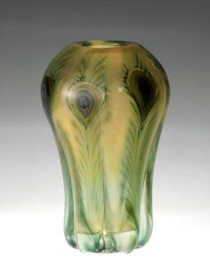 This is a paperweight-style vase of transparent green-tinted glass. The base is six-petalled and the body is divided into six rounded sections by deep indentations th … Tiffany Art, Tiffany Glass, Glass Vessel, Glass Art, Chrysler Museum, Light Shield, Wall Hanging Shelves, Leaded Glass Windows, Louis Comfort Tiffany