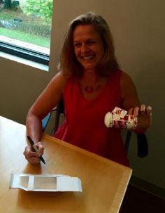 Edie 's official signature Proofing the new box design for the Love Shaker!