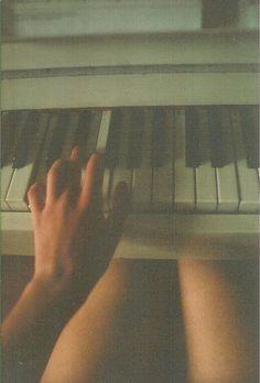 girl playing piano.