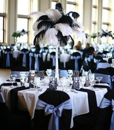 Black and White Wedding Reception Feather Centerpiece and Chair Bows.