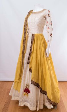 Like the white anarkali and yellow dupatta combo. Don't wanna get it sew though Indian Fashion Dresses, Indian Gowns Dresses, Dress Indian Style, Indian Designer Outfits, Pakistani Dresses, Indian Outfits, Ivory Prom Dresses, Indian Fashion Trends, Indian Clothes