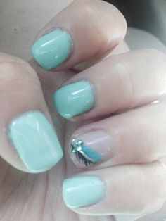 Gel manicure. Feather accent nail. Trying out a new nail tech today.