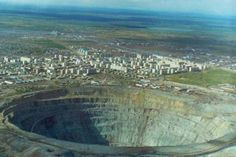 Mirny Diamond Mine - Eastern Siberia, Russia: The world's second largest man-made hole, Mirny was constructed by Stalin to satisfy the Soviet Union's demand for industrial diamond. Further digging efforts were eventually abandoned when it became too difficult to continue digging this massive hole