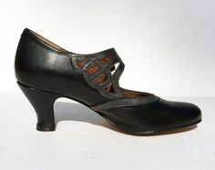 """Our latest 1920's pump with intricate arch strap cut outs in tonal contrasts. - Leather uppers with leather soles - Whole and half sizes, 5 ½ - 11 - Medium widths - 2 ¼"""" heel - Available in Black Comb"""