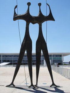 """Sculpture """"The Candangos"""" / """"The Warriors""""  by Bruno Giorgi on the Praça dos Três Poderes, Brasilia and Palácio do Planalto Building by Oscar Niemeyer"""