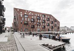 COBE + vilhelm lauritzen mimics existing warehouses in copenhagen housing project