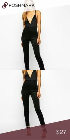 Plunging neckline jumpsuit This is a black plunging jumpsuit that is 96% polyester 4% spandex it has an extra lining which is 100% polyester has a very good stretch to it do not pass this one up ladies this is a very sexy jumpsuit make an offer or bundle two and receive a discount Dresses