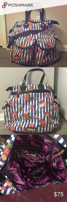 NWOT Betsy Johnson Nautical Floral Weekender Bag NWOT Betsey Johnson nautical floral weekender bag, perfect condition. Colorful bag has plenty of room inside as well as 5 outside pockets. Lined with dark purple satin with logo everywhere. Design is blue and white stripes with anchors and roses, and is covered everywhere with clear sequins. Perfect for overnight and weekend getaways! Betsey Johnson Bags Travel Bags