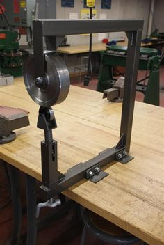 An english wheel is a classic hand-powered shop tool for making two-dimensional curves in sheet metal.  Its used for making aircraft skins, car body parts, suits of armor and other applications where a smooth surface on the sheet is desired, something extremely difficult to achieve with a hammer.  It is also very useful for planishing; smoothing dimpled or bumpy sheet metal after hammering. An english wheel seemed like an excellent tool to build.  I read up on the theory of op...