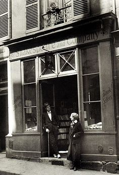 James Joyce and Sylvia Beach in front of Shakespeare and Co. in Paris. via The Spiral Bookcase http://thespiralbookcase.tumblr.com/page/2