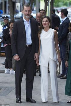 Felipe, 50, looked smart in a blue shirt and suit as he and his wife arrived at the event