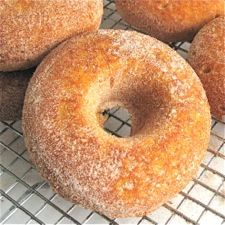 Pumpkin Cake Doughnuts...With their brilliant orange color, pleasingly moist texture, and delightful pumpkin flavor, these baked (not fried) doughnuts are the perfect on-the-go breakfast for a crisp autumn day.
