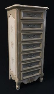 ATTRACTIVE LINGERIE BUREAU IN A PUTTY AND OFF WHITE COLOR WITH WHITEWASHED DRAWER PULLS, BEVELED TOP AND STENCILED PATTERN ON THE SIDES. 58H X 26W X 18D