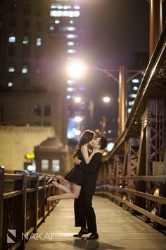 Chicago Wedding Photographer: Nakai Photography. Fun & Cute Chicago engagement photo at night- kissing on a bridge! Asian (Korean) couple in a black suit, black dress + black heels! Want to see more from this engagement session? http://www.nakaiphotography.com/engagement-photos/chicago-urban-night-carnival-lyric-opera-bridge-hyejin-jon/