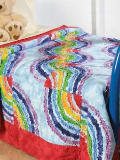 Ragged flannel strips create the soft, flowing curves of this rainbow-colored quilt. Quilt Size: x Skill Level: Beginner Free Baby Quilt Patterns, Barn Quilt Patterns, Patchwork Quilt Patterns, Beginner Quilt Patterns, Quilting Patterns, Free Pattern, Sewing Patterns, Ruffle Quilt, Rainbow Quilt