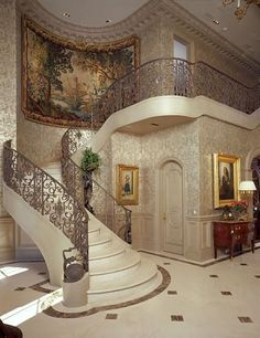 Glam entry. I love the detail in the iron work, tile design, molding and the flowing arch work.