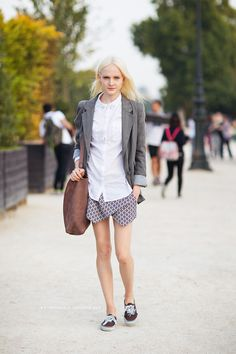 white blouse with studded collar, gray blazer, brown tote, patterned skort, brown sneakers