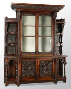 Cincinnati art carved cabinet, 1876, attributed to William H. Fry