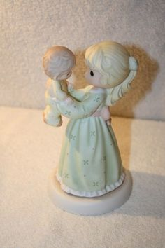 "Precious Moments 'Happiness is being a mom' porcelain figurine measures approx: 6 1/4"" x 3.5""D from 2003 MINT #115926 $20"