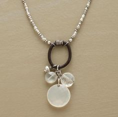 "A pair of faceted moonstones and a single round of white chalcedony dance circles on a ring of leather. Chain of sterling seed beads. Lobster clasp with 2"" extender chain. Handmade in USA. Exclusive. 17""L."