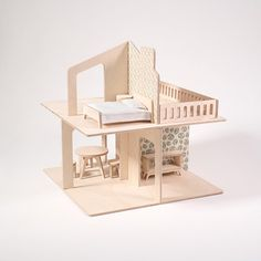 Wooden modern dollhouse and its furniture made from certified