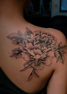 Large flower shoulder tattoo. I'd like something like this for my and Logan's flowers.