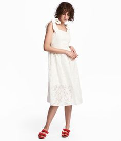 White. Dress in woven cotton-blend fabric with eyelet embroidery. Wide tie shoulder straps, concealed side zip, seam at waist, and flared skirt. Lined.
