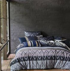 Linen House Metrique Charcoal Quilt Cover  Featuring a spectacular geometric design in an eye-catching colour palette of purple silver grey and black Metrique is every bit the mid-century lover's bed linen in all of its jacaquard yarn-dyed glory. Finished with a printed geometric reverse and cord piping on the edges  http://ift.tt/2a0e2z5  #quiltcover #manchester #homewares #interiordesign #living #bedroom #decor #fashion #linen #bedlinen #summer #modern #bedding #homedecor #style #fun #life…