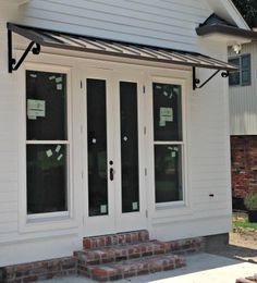 The Bronze Classic Metal awning with the Single S Scrolls in New Orleans, LA Front Door Awning, Porch Awning, Diy Awning, Metal Awning, Diy Exterior Window Awning, Metal Door Canopy, Outdoor Window Awnings, Porch Overhang, Patio Awnings