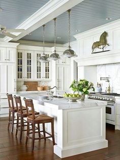 Love this kitchen ceiling with blue grey wainscotting and chunky white beams!