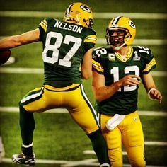 Jordy Nelson Photos - Jordy Nelson and Aaron Rodgers of the Green Bay Packers celebrate after a 29 yard touchdown pass against the Pittsburgh Steelers during Super Bowl XLV at Cowboys Stadium on February 2011 in Arlington, Texas. Packers Baby, Go Packers, Green Bay Packers Fans, Packers Football, Football Season, Football Players, Greenbay Packers, Football Awards, Football Memes