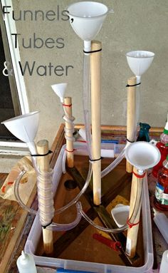Water play with funnels, tubes, and wooden dowels. This would be an excellent center to have on the playground this summer.