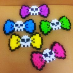 Check out this item in my Etsy shop https://www.etsy.com/listing/507607033/perler-bead-sugar-skull-hair-bow-clips