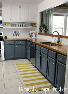 Grey, white, and yellow kitchen - I love this kitchen! Especially the shelves underneath the cabinets.