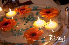 #wedding reception decorations #centerpieces #tablescapes #reception details #Michigan wedding #Mike Staff Productions #wedding details #wedding photography http://www.mikestaff.com/services/photography #floating candles #flowers