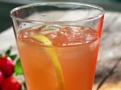 Strawberry Basil Lemonade   2 cups sugar  1 pound strawberries, hulled and sliced  1/2 cup tightly packed fresh basil leaves  2 cups fresh lemon juice  Ice, for serving  Sliced lemons, for garnish