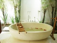 zen stone tub with pebble outer lining and bamboo