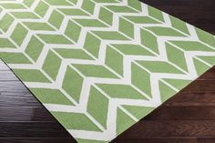 Surya Fallon FAL-1087 Area Rug From delicate lattice patterns to boldly colored chevron patterns the Fallon Collection makes a statement in flat weave; from creator Jill Rosenwald known for her beautifully colored, hand-made ceramics.