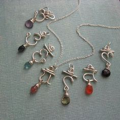 Set of 7 Chakra Pendants with semi-precious stones. $185.00, via Etsy.