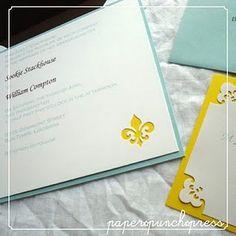 yellow and lighter teal, fleur de lis