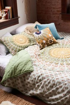 Bring a symbol of the universe to your bedroom with this mandala bedding set, featuring neutral colors and a mandala design! This bedding set comes with a comfy quilt and two matching shams in Full/Queen size. You'll sleep in comfort and great boho style!