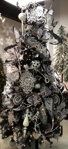 Black and white Christmas tree...like the butterfly and b/w polka dot ornaments but I think as a whole the tree could use a few less ornaments. Christmas Wreaths, Merry Christmas, Black Christmas Tree Decorations, Black Christmas Trees, Holiday Tree, Beautiful Christmas Trees, Christmas 2014, Christmas Colors, Butterfly Ornaments