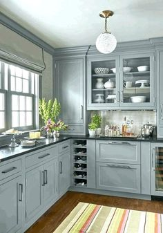 (paid link) Second lonesome to white in terms of popularity, espressokitchen cabinetsare a beautiful, elegantdeep dark woodthat pairs without difficulty as soon as classic whites and creams,... Kitchen Black Counter, Blue Gray Kitchen Cabinets, Black Kitchen Countertops, Light Gray Cabinets, White Cabinets, Painted Gray Cabinets, Repainting Kitchen Cabinets, Kitchen White, Light Blue Kitchens