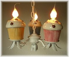 OMGoodness! pink, blue, tan cupcake chandelier with white iron metal flower base. Angel Heart Designs.  I may have to decorate my next kitchen with a cupcake theme!