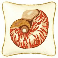 "Bring a touch of coastal charm to your living room or den with this charming pillow, showcasing an embroidered nautilus shell motif and rope-inspired trim.   Product: PillowConstruction Material: Linen-cotton blend cover and polyester fillColor: NaturalFeatures: Rope-inspired trimEmbroidered detailsInsert includedDimensions: 16"" x 16"""