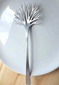 Salad fork. I'd probably stab myself multiple times in the span of one meal. But its pretty!