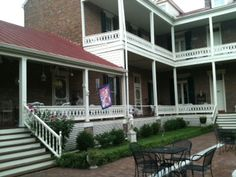 We started our tour with a brief history lesson by owner Bobbi Kaslow on the back porch. I'd love to sit out there and read or write. Beautiful courtyard, also. Photo by Betty Bolte